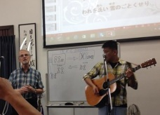Steve Franklin speaking at a bilingual church service